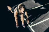 sportswoman in starting stance