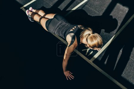 sportswoman doing push ups
