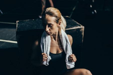 sportswoman with towel on shoulders