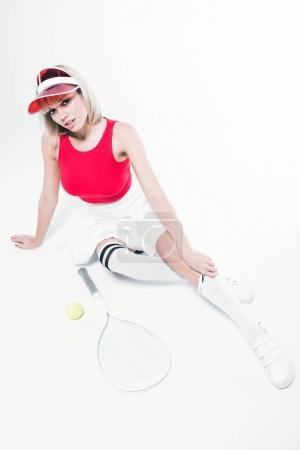 fashionable woman with tennis equipment