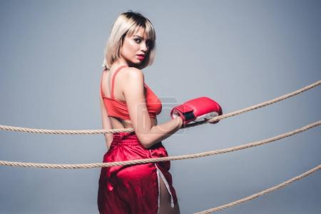 beautiful woman in sportswear and boxing gloves