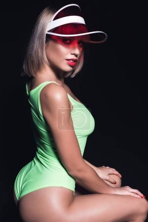 Sexual woman in bodysuit and cap
