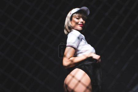 beautiful woman in tennis shirt