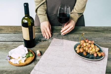 Sommelier holding glass of wine