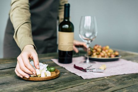 taster taking piece of brie cheese