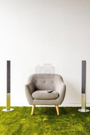 Armchair with remote controller and loudspeakers