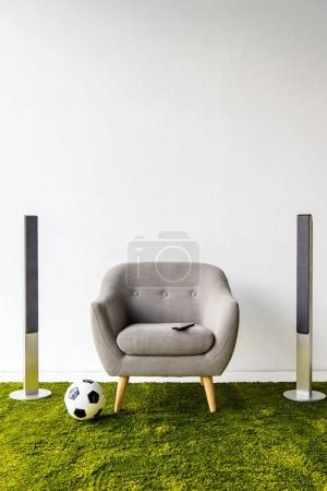 Armchair with remote controller, ball and loudspeakers