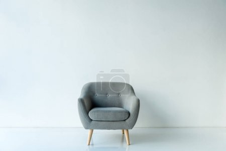 Empty armchair in room