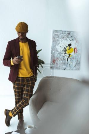 handsome african american businessman with smartphone