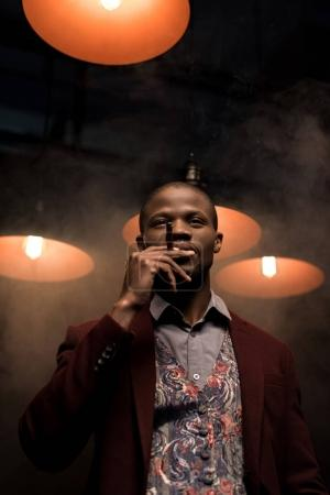 african american man smoking cigar