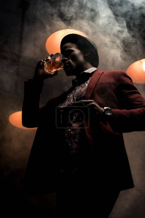 african american man in hat with whiskey