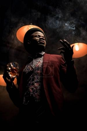 handsome man with whiskey and cigar