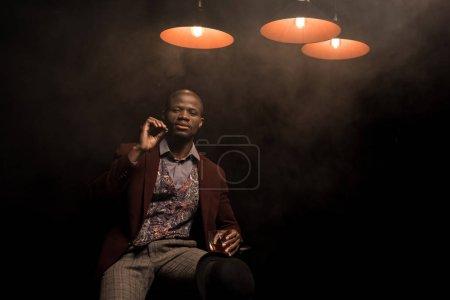 man with cognac smoking cigar