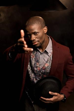 african american man with hand gun