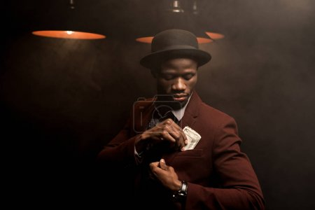 rich african american man with money