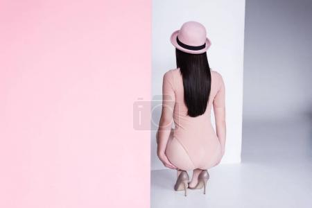 young woman in bodysuit