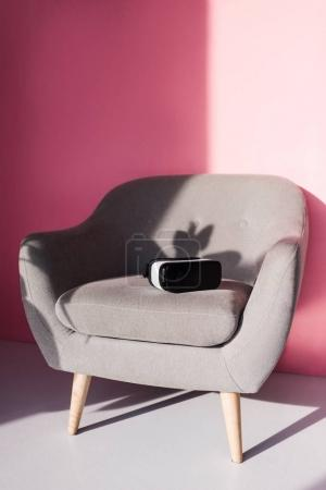 Virtual reality headset on armchair
