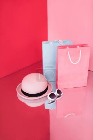 shopping bags, hat and sunglasses