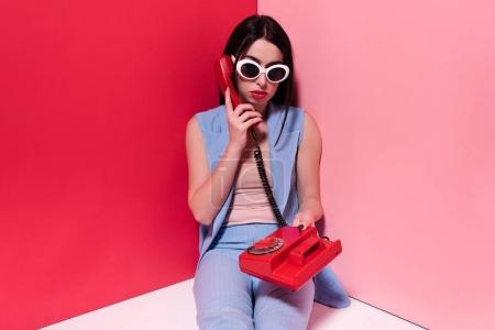 stylish girl with retro phone