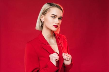 Photo for Portrait of elegant stylish girl posing in red jacket, isolated on red - Royalty Free Image