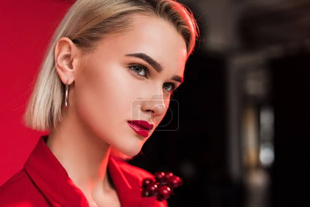 Photo for Portrait of attractive stylish girl in red jacket with boutonniere - Royalty Free Image