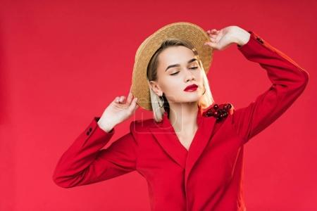 girl in red jacket and straw hat