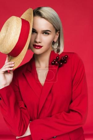 girl in red jacket with boutonniere and hat