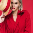 Attractive girl in red jacket with boutonniere and...