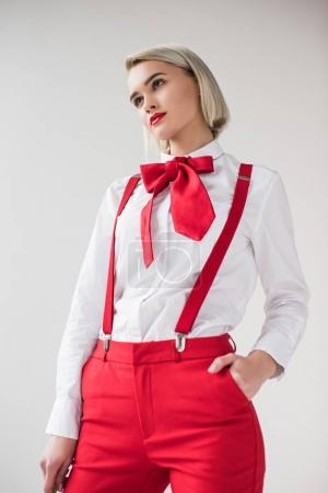 fashionable girl in red suspenders and bow
