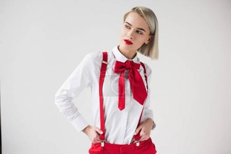 stylish girl in red suspenders and bow