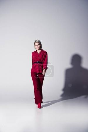 elegant girl in red trendy clothes