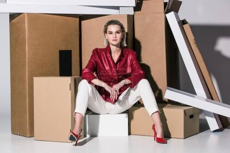 fashionable girl on cardboard boxes