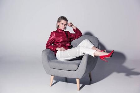 attractive stylish girl in armchair