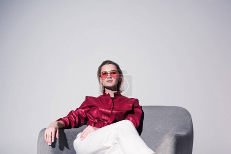 stylish girl posing in armchair