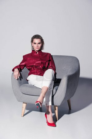 fashionable girl in armchair