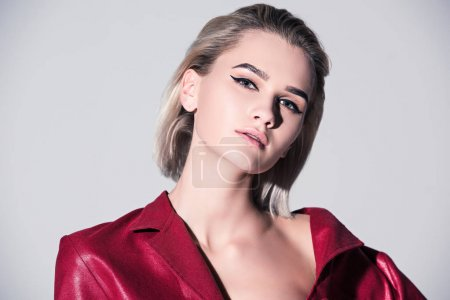 Photo for Beautiful style girl posing for fashion shoot, isolated on grey - Royalty Free Image