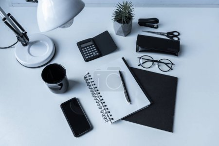 overhead view of notebook and pen on working table