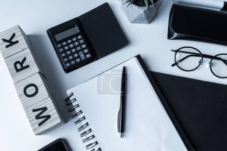 overhead view of working table with notebook and pen