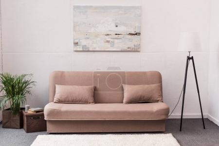 Photo for Interior of stylish living room with comfortable couch - Royalty Free Image