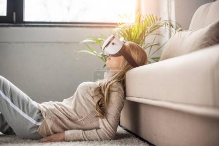 beautiful young woman in virtual reality headset at home