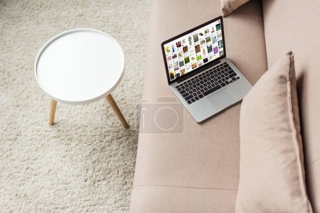 high angle view of laptop standing on cozy couch with pinterest website on screen