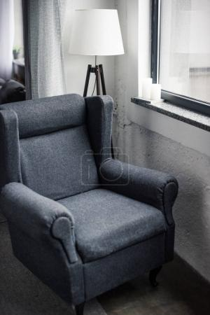 comfortable armchair near window in modern apartment