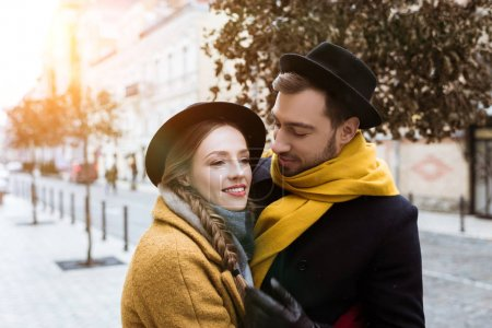 attractive young couple hugging in autumn outfit
