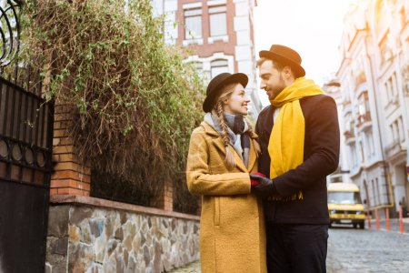 beautiful young couple in autumn outfit looking at each other