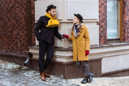 young attractive couple holding hands and looking at each other