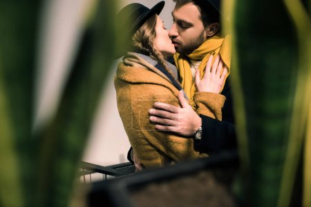 Photo for Young attractive couple kissing in autumn outfit - Royalty Free Image