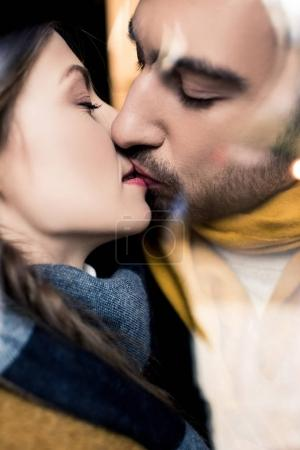 young tender kissing couple, closeup