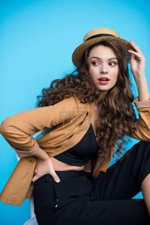 Photo for Beautiful young woman in stylish canotier hat and jacket looking away - Royalty Free Image
