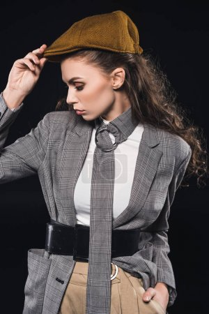 Photo for Portrait of elegant fashionable young woman looking away isolated on black - Royalty Free Image