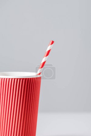 Photo for Close-up view of red paper cup with drinking straw isolated on grey - Royalty Free Image